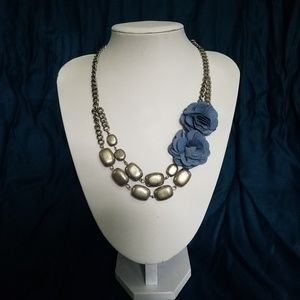 Silver tone necklace with flower detail